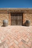 Barn door with patio in foreground. Patio with Shed in Background Stock Photography