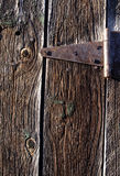 Barn Door Segment. Old weathered barn boards and rusty strap hinge Stock Images