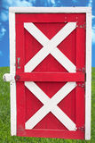 Barn door on sky and grass Royalty Free Stock Photos