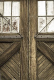 Barn Doors. Rustic distressed barn doors with symmetrical appearance Royalty Free Stock Photo