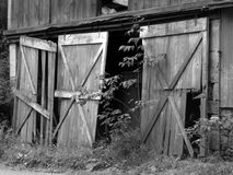 Barn Doors. Black white doors of Old barn in country Royalty Free Stock Photo