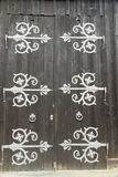 Barn doors with large decorative hinges. Royalty Free Stock Photo