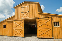 Barn doors and windows. A view of a new wooden farm barn with sliding doors and a second story Stock Images