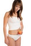 barn för äppleholdingkvinna Arkivfoton