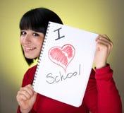 barn för flickaholdinganteckningsbok Fotografering för Bildbyråer