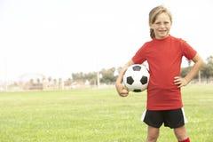 barn för fotbollflickalag arkivbilder