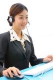 barn för kvinna för hörlurar med mikrofon för affärsdator Arkivbilder