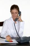barn för kvinna för skrivbordtelefon talande Arkivbild