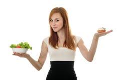 barn för sallad för grönsallat för affärskvinnacake choice Arkivfoto