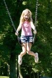 barn för swing för set för flickapark leka Royaltyfri Foto