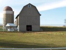 Barn on a farm. Old wooden barn on a farm Stock Image