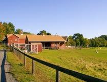Barn on Farm. Red Barn on Farm with Fence Stock Photos