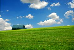 Barn in farm field Royalty Free Stock Image