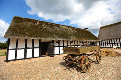 Barn farmhouse with wooden cart Royalty Free Stock Photo