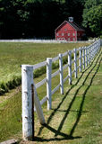 Barn and Fence. White Fence and Red Barn in Vermont Stock Image