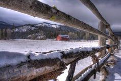Barn through a fence view. Royalty Free Stock Photos