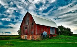 Barn on Field Against Sky Stock Photos