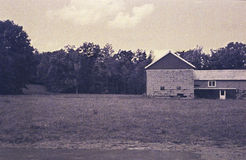 Barn and field. Barn structure and surrounding field Royalty Free Stock Photography