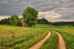 A barn in fields. Overcast day at the barn in the Bavarian fields Royalty Free Stock Photo