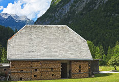 Barn with firewood, Slovenia. Old barn with stacked wood in the Julian Alps near Trenta, Slovenia Royalty Free Stock Photo