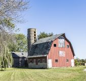 Barn With Flad. Barn in rural are displaying old glory Stock Images