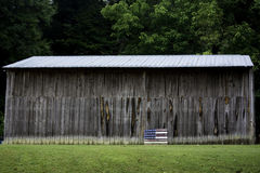 Barn and Flag Royalty Free Stock Photography