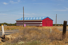Barn with flag Royalty Free Stock Photography