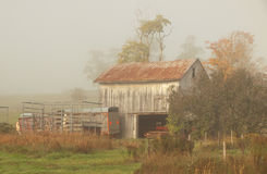 Barn in fog Royalty Free Stock Photos