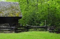 Barn in forest Stock Images