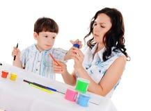 Barn fostrar och sonen Fotografering för Bildbyråer