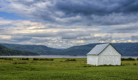 Barn in front of the fjord Stock Images