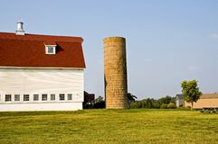 Barn with Gambrel Roof and Silo Stock Photography
