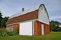 Barn or Garage. A former barn is renovated into a garage in a rural setting Stock Photos
