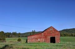 Barn in green field. Stock Photography