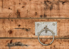 Barn Hardware. A halter tie ring for livestock in the barn stock photography