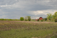 Barn with harvested field Royalty Free Stock Images