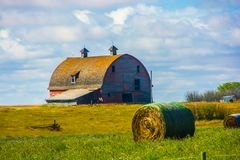 Barn and Hay along Highway in Western Wyoming. On hill in rural Wyoming Stock Images