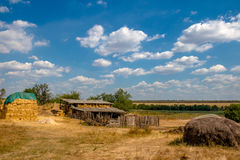 Barn and hayloft in the village. Ukrainian summer Royalty Free Stock Image
