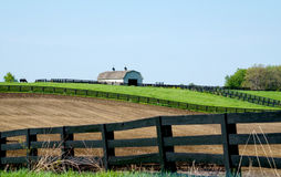 Barn on a hill with lots of fence Royalty Free Stock Images