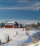Barn on hill in winter Stock Photo