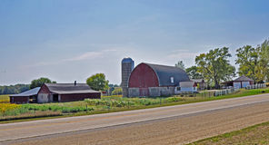 Barn and house near Madison, Wisconsin. Traditional red barn on family farm in Wisconsin stock photo