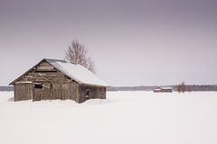 Barn Houses In Winter 1. The snow fell on the fields leaving the barn houses alone in the middle of the fields stock photo