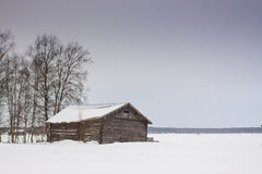 Barn Houses In Winter 3. The snow fell on the fields leaving the barn houses alone in the middle of the fields royalty free stock photos