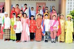 Barn i den nationella klänningen för ASEAN-gemenskap Royaltyfria Foton