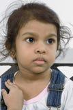 Barn i djup tanke. Arkivbild