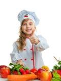 Barn i köket som förbereder ett mål Royaltyfri Fotografi