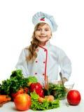 Barn i köket som förbereder ett mål Royaltyfri Bild