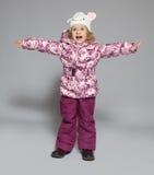 Barn i vinterkläder Fotografering för Bildbyråer