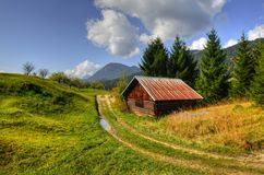 Barn. Inset into the Alpine landscape in the middle of pastures Stock Images