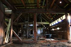 Barn from inside with low light. Slovenia before demolishen Royalty Free Stock Photos